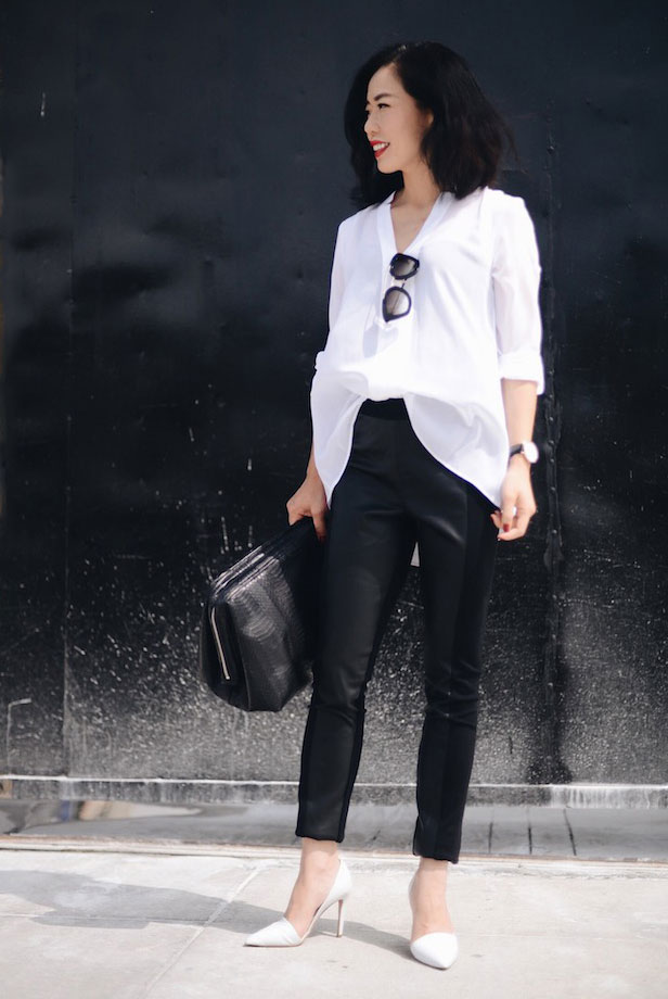black leather pants, an oversized shirt, black bag and white heels