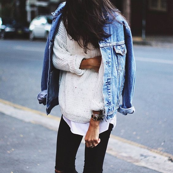 black ripped jeans, a white tee, a white sweater and a jacket
