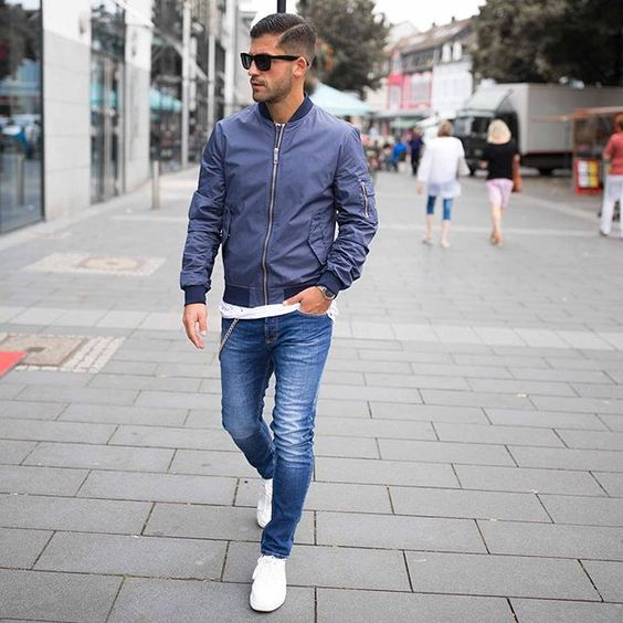 blue jeans, a white t-shirt, a blue moto jacket and white sneakers