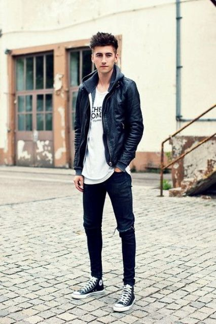 black leather jacket, a printed tee, black ripped jeans and leather Converse