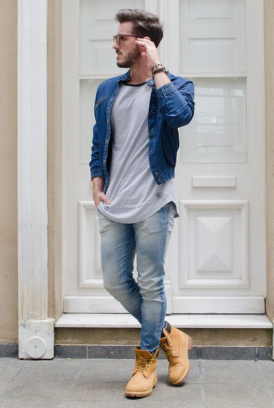 blue jeans, a grey tee, a denim jacket and yellow boots