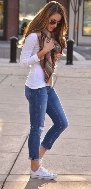 blue jeans, a white long-sleeve and a plaid scarf