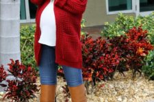09 blue jeans, a white top, a long red cardigan and cognac high boots