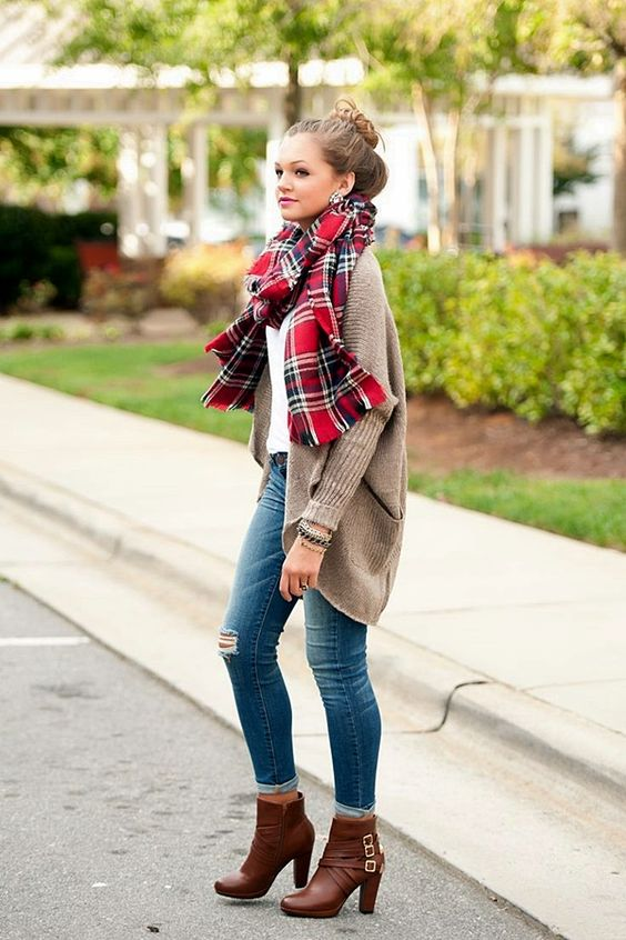 blue ripped jeans, a brown long cardigan and a plaid scarf