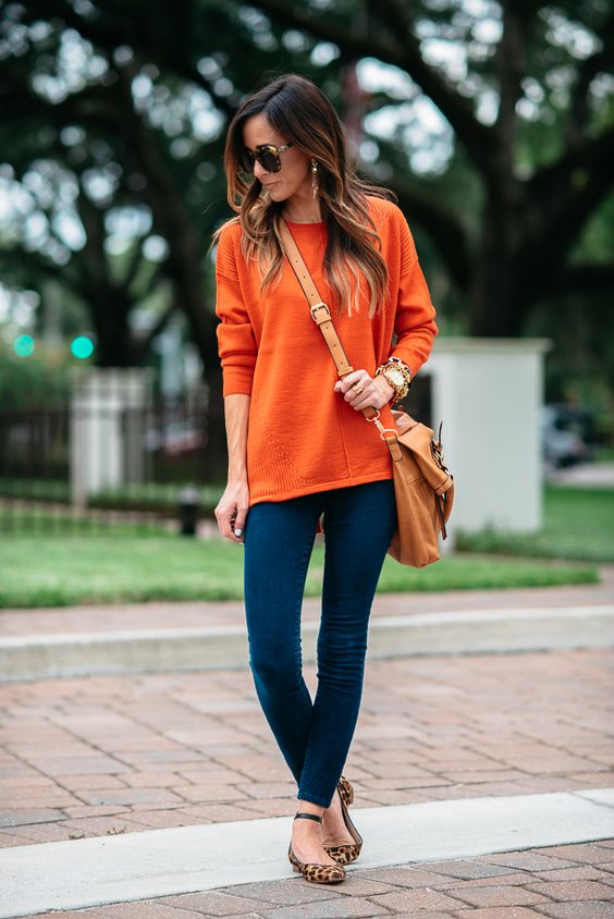 blue skinnies, an orange sweater and leopard flats