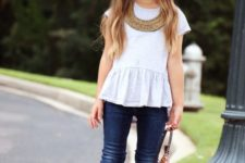 09 jeans, boots, a white peplum top and a hat