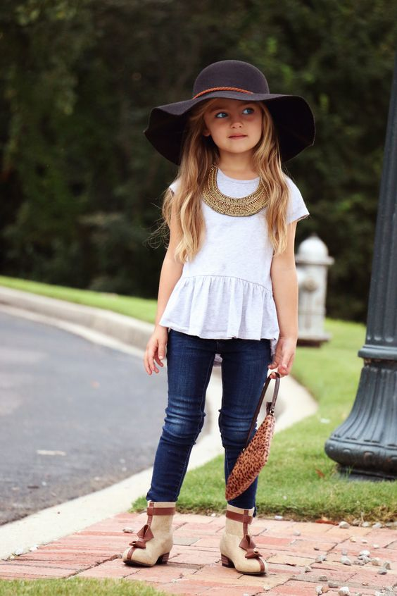 jeans, boots, a white peplum top and a hat