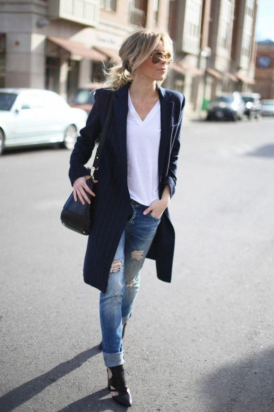 ripped jeans, a white tee, black cutout shoes and a long blazer