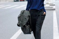 10 black trousers, a navy blouse and silver shoes