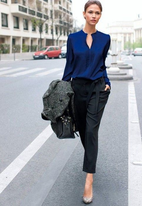 black trousers, a navy blouse and silver shoes