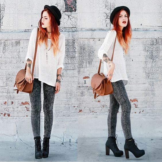 grey jeans, a white shirt, a hat and black heeled boots