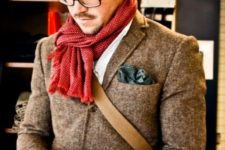 11 a brown blazer, a red scarf and glasses