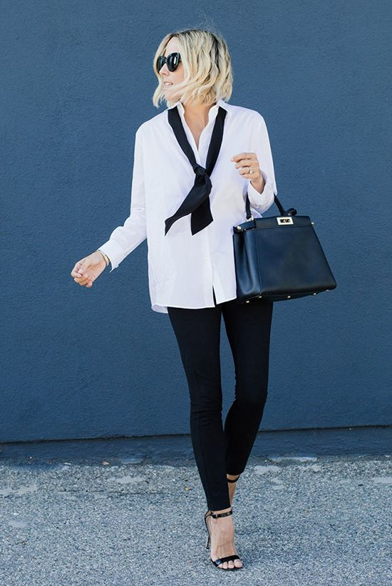 black leggings, a white shirt, a black tie and heels