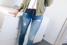 11 blue jeans, a white top, an olive green moto jacket