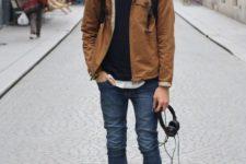 11 blue rolled up jeans, a black sweater, an ocher jacket