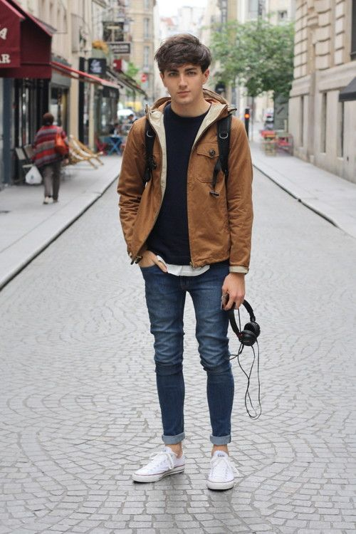 Picture Of blue rolled up jeans a black sweater an ocher jacket
