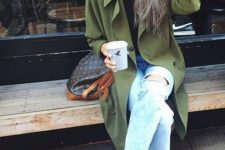 11 distressed denim, a flowy green trench coat and grey lace up flats