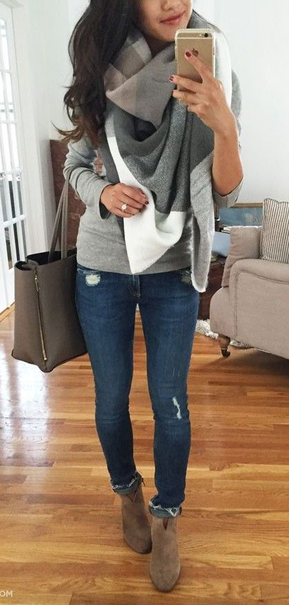 grey jersey, blue jeans, a checked scarf and brown ankle boots