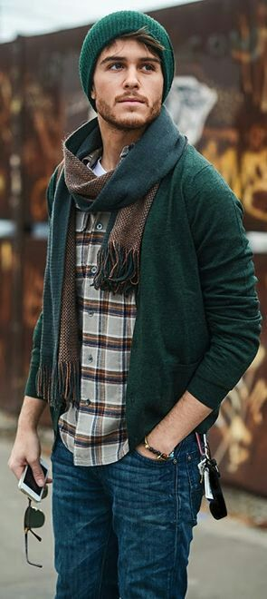 jeans, a plaid shirt, a green cardigan and a scarf