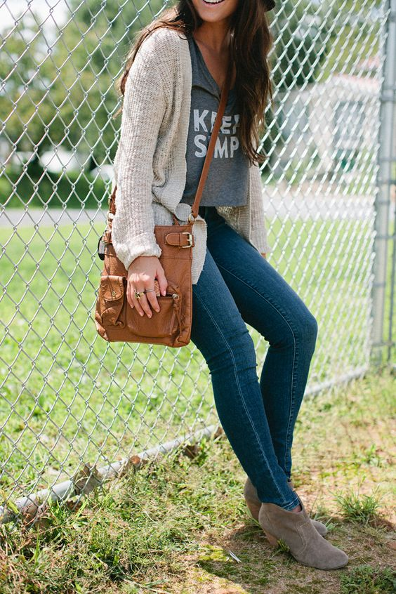jeans, a printed crop top, a cardigan and grey ankle booties
