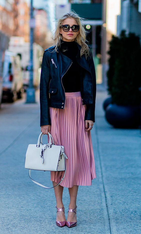 pleated pink midi skirt, pink shoes, a black jersey and a black leather jacket