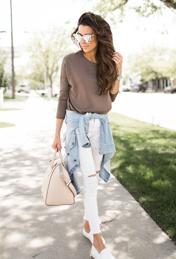 taupe top, white ripped jeans, white slip ons and a blue jacket
