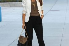 12 black trousers, an olive green top, a white blazer and brown shoes