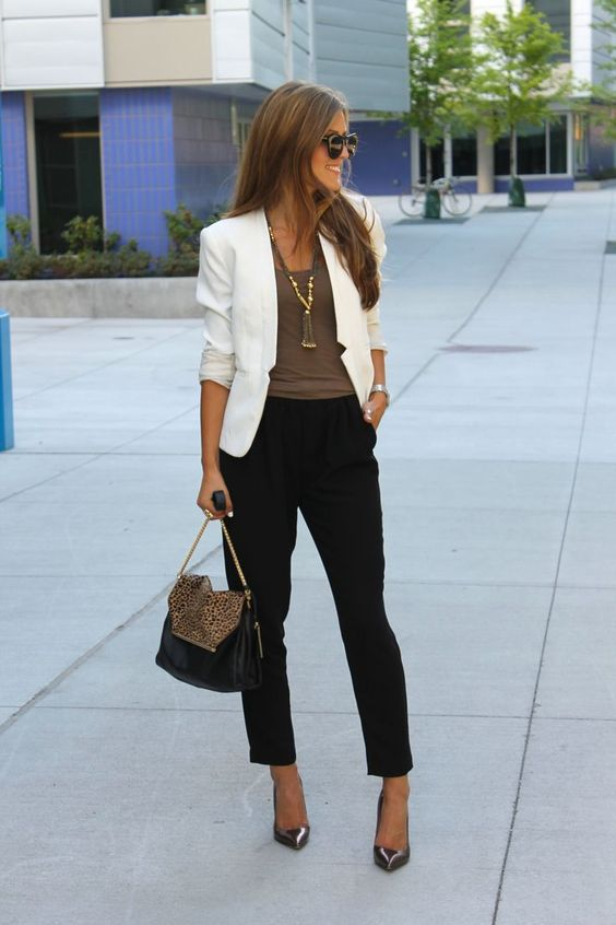 black trousers, an olive green top, a white blazer and brown shoes