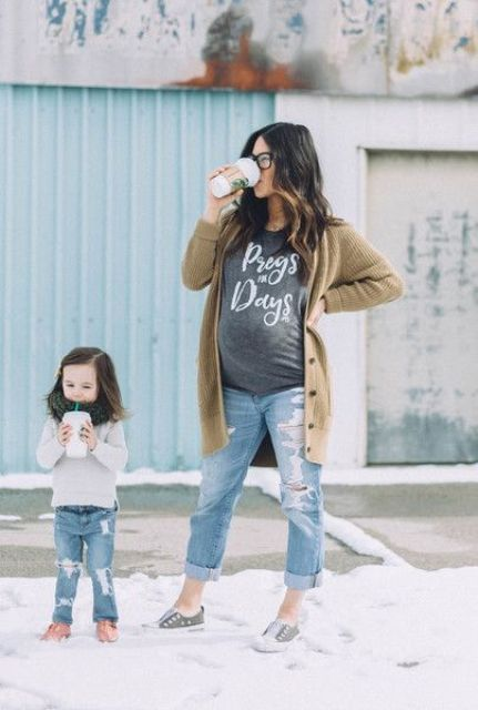 distressed denim, an oversized t-shirt, a long cardigan and sneakers