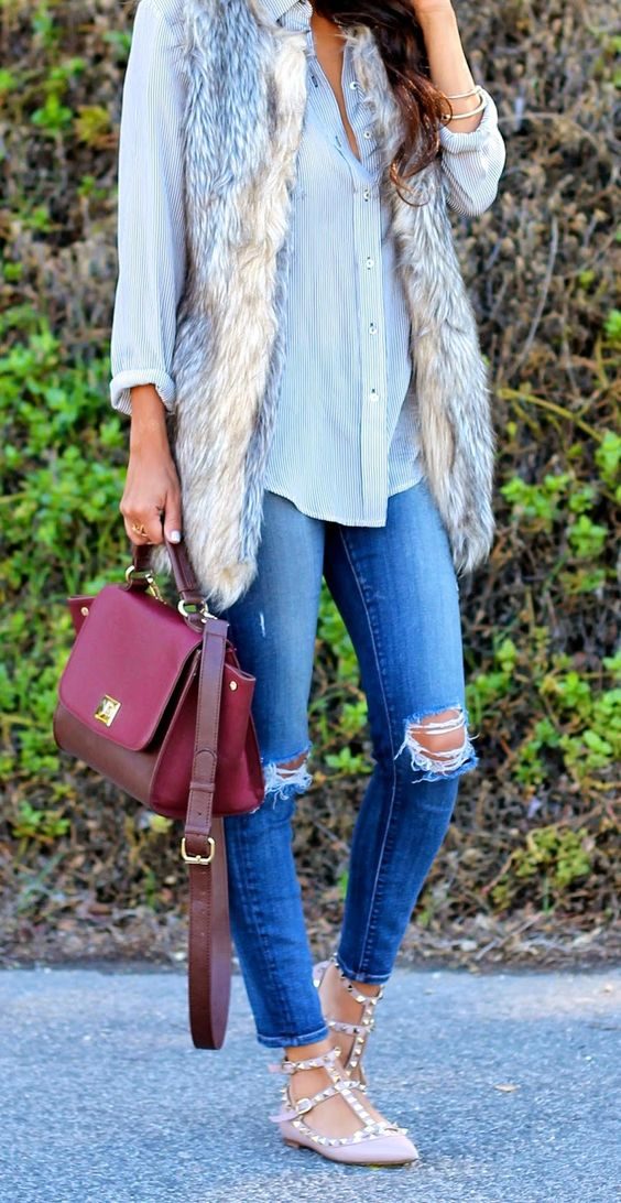 distressed jeans, a fur vest, a blouse, rockstud flats
