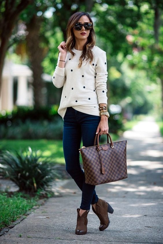 navy jeans, a dotted white jersey and brown boots and a bag