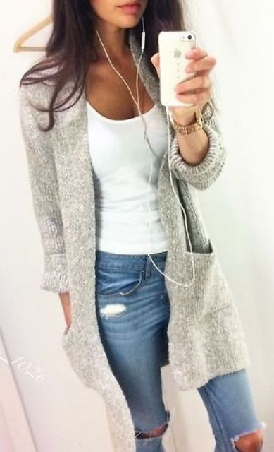 ripped jeans, a white top and a long grey cardigan
