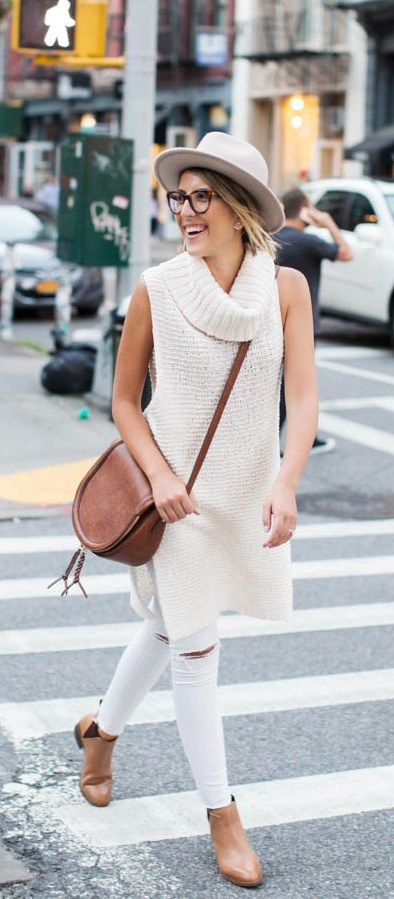 white ripped jeans, a long crochet top, ankle boots and a crossbody bag