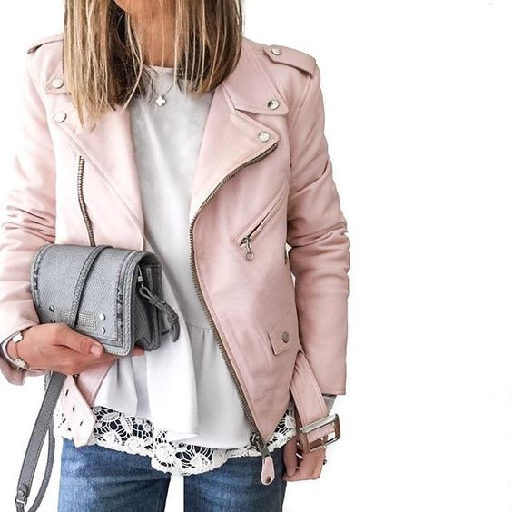a cute pink leather moto jacket, blue jeans and a white lace top