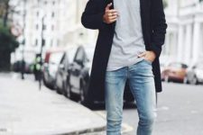 13 blue skinnies, a grey t-shirt, a black coat and white sneakers
