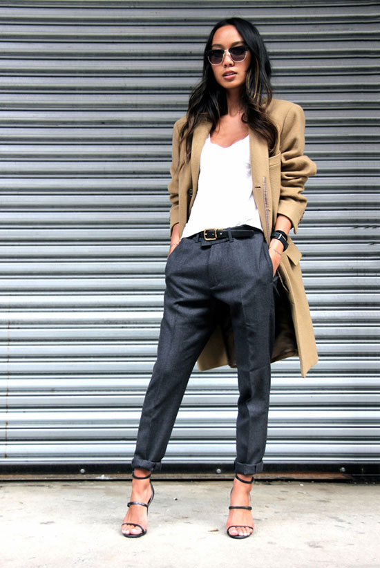 grey cropped pants, a white top, a camel coat and heels