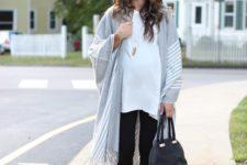 13 grey fringe poncho, black leggings, a white t-shirt and lace up flats