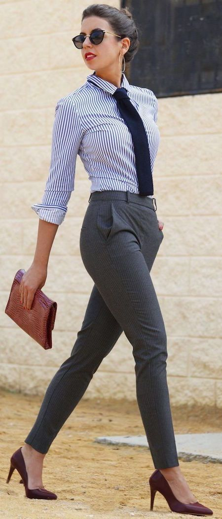 grey trousers, a striped shirt, a tie and burgundy shoes