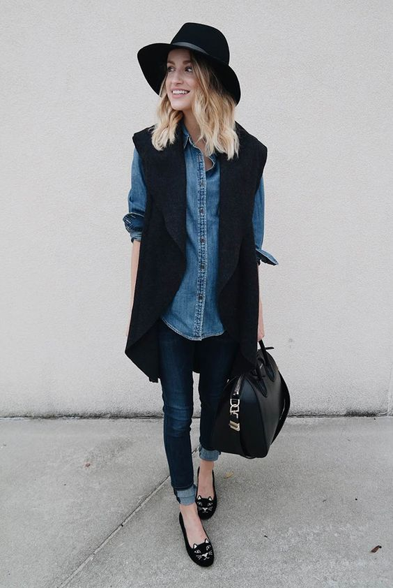 navy jeans, a denim shirt, a black sleeveless coat and cat loafers