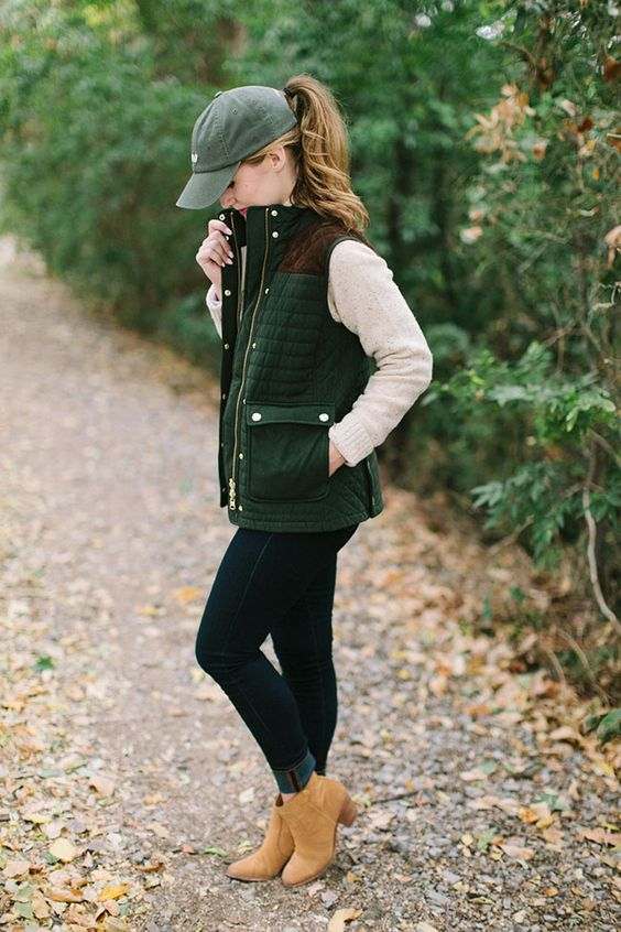 navy jeans, a nude sweater, a quilted vest and ocher boots