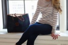 13 navy skinny jeans, a striped jersey and tan and black flats