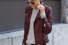 14 black jeans, a grey tee and a burgundy leather jacket