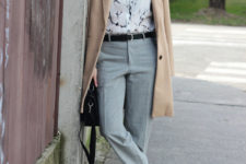 14 grey pants, a printed shirt, white sneakers and a camel coat