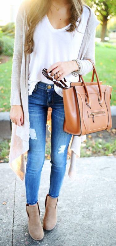 jeans, a white top, a grey long cardigan and tan boots