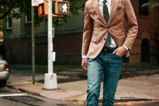 14 ocher jacket, blue jeans, a white shirt and a tie