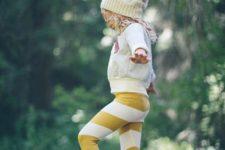 14 white sweatshirt, striped pants, a knit hat