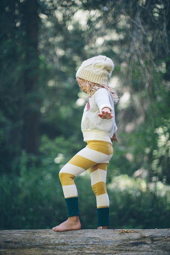 white sweatshirt, striped pants, a knit hat