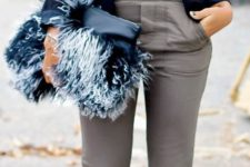 15 grey trousers, a black top, a navy shoulderpad jacket and a fluffy clutch