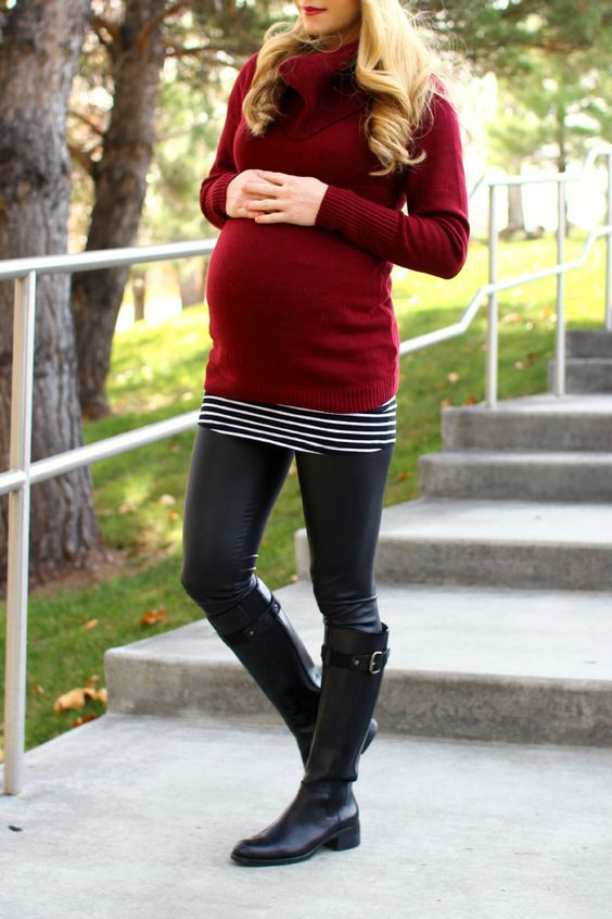 leather leggings, a red turtle neck sweater and black boots