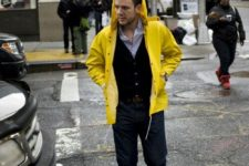 15 navy jeans, a black cardigan and a yellow rain coat